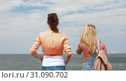 Купить «teenage girls or friends walking at seaside», видеоролик № 31090702, снято 25 июня 2019 г. (c) Syda Productions / Фотобанк Лори
