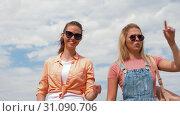 Купить «teenage girls or friends walking in summer», видеоролик № 31090706, снято 25 июня 2019 г. (c) Syda Productions / Фотобанк Лори