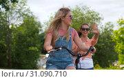 Купить «teenage girls or friends with bicycle in summer», видеоролик № 31090710, снято 25 июня 2019 г. (c) Syda Productions / Фотобанк Лори