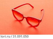 Купить «red sunglasses on red background», фото № 31091050, снято 21 июня 2019 г. (c) Майя Крученкова / Фотобанк Лори