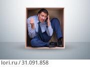 Employee working in tight space. Стоковое фото, фотограф Elnur / Фотобанк Лори