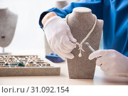 Купить «Young jeweler working in his workshop», фото № 31092154, снято 19 декабря 2018 г. (c) Elnur / Фотобанк Лори
