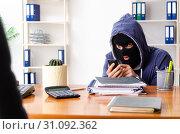 Купить «Male thief in balaclava in the office», фото № 31092362, снято 8 февраля 2019 г. (c) Elnur / Фотобанк Лори