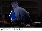 Купить «Male thief in balaclava in the office night time», фото № 31095094, снято 22 апреля 2019 г. (c) Elnur / Фотобанк Лори