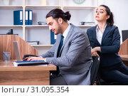 Купить «Two employees working in the office», фото № 31095354, снято 15 апреля 2019 г. (c) Elnur / Фотобанк Лори