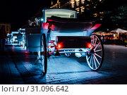 Купить «The old square of the night krakow with luminous horse-drawn carriages», фото № 31096642, снято 27 июля 2017 г. (c) easy Fotostock / Фотобанк Лори