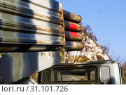 Купить «Camouflage military truck with rocket launcher. Outdoor military vehicles museum. Armor is damaged at the battlefield. Missile firing system on military armored truck close up view. Rocket launcher.», фото № 31101726, снято 10 ноября 2018 г. (c) easy Fotostock / Фотобанк Лори
