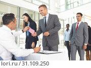 Купить «Group of diverse business people waiting in line for registering », фото № 31109250, снято 21 марта 2019 г. (c) Wavebreak Media / Фотобанк Лори