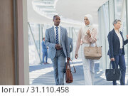 Купить «Diverse business people interacting with each other in corridor in modern office», фото № 31110458, снято 21 марта 2019 г. (c) Wavebreak Media / Фотобанк Лори