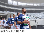 Купить «Group of Male rugby players entering stadium in a row for match», фото № 31110790, снято 9 мая 2019 г. (c) Wavebreak Media / Фотобанк Лори