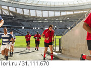 Купить «Male rugby players returning the dressing room after the match», фото № 31111670, снято 9 мая 2019 г. (c) Wavebreak Media / Фотобанк Лори