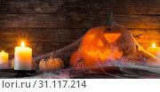 Купить «Jack O Lantern Halloween pumpkin, spiders on web and burning candles», фото № 31117214, снято 13 октября 2017 г. (c) easy Fotostock / Фотобанк Лори