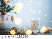 Купить «white cup and christmas decorations on white background», фото № 31226326, снято 13 декабря 2018 г. (c) Майя Крученкова / Фотобанк Лори