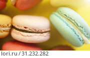 Купить «Macaroon. The bright colored rolls, cookies. The background substrate.», фото № 31232282, снято 20 августа 2017 г. (c) easy Fotostock / Фотобанк Лори
