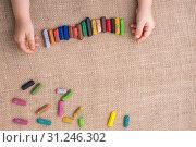 Купить «Toddlers hand putting crayons in line on canvas», фото № 31246302, снято 6 мая 2017 г. (c) easy Fotostock / Фотобанк Лори