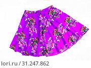 Купить «Bright colored fashionable summer floral skirt for women / girl, isolated on white / Stylish summer flower skirt isolated on white background.», фото № 31247862, снято 22 марта 2017 г. (c) easy Fotostock / Фотобанк Лори