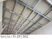 Купить «Skeleton of a ceiling from a metal profile, for the subsequent drywall sheets», фото № 31251502, снято 23 марта 2018 г. (c) easy Fotostock / Фотобанк Лори