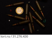 Купить «Rifle ammo around one euro coin wigh gemstones on black background. Symbolizes the war for money and one of the world's problems.», фото № 31276430, снято 19 августа 2018 г. (c) easy Fotostock / Фотобанк Лори