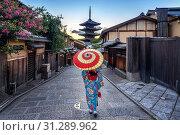 Купить «Woman wearing japanese traditional kimono with umbrella at Yasaka Pagoda and Sannen Zaka Street in Kyoto, Japan.», фото № 31289962, снято 31 июля 2018 г. (c) easy Fotostock / Фотобанк Лори