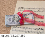 Купить «Banknote bundle of US dollar tied with colorful a ribbon», фото № 31297250, снято 18 февраля 2017 г. (c) easy Fotostock / Фотобанк Лори