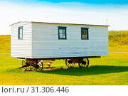 Купить «Longview August 2015 This wooden house on wheels , located in bar u ranch national historic site is visited by tourists in this period to see where the drovers lived in 19th century», фото № 31306446, снято 3 июля 2020 г. (c) easy Fotostock / Фотобанк Лори