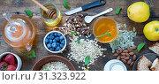 Купить «Concept: Healthy lifestyle. Healthy breakfast with fresh fruits, oat flakes and green tea», фото № 31323922, снято 21 января 2020 г. (c) easy Fotostock / Фотобанк Лори