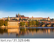 Купить «The view of Prague castle, St. Vitus Cathedral and the Vltava river. Prague, Czech Republic», фото № 31329646, снято 7 сентября 2014 г. (c) Наталья Волкова / Фотобанк Лори