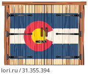 Купить «A large closed wooden barn double door with bolt and hinges and the Colorado flag painted on», фото № 31355394, снято 29 декабря 2018 г. (c) easy Fotostock / Фотобанк Лори