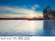 Winter paysage landscape of sunset evening iced frozen lake river. Стоковое фото, фотограф YAY Micro / easy Fotostock / Фотобанк Лори