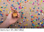 Купить «Little chair in hand amid colorful pebbles on canvas», фото № 31367802, снято 9 октября 2017 г. (c) easy Fotostock / Фотобанк Лори