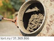 Купить «Construction site work with concrete mixer and wheelbarrows», фото № 31369866, снято 22 апреля 2018 г. (c) easy Fotostock / Фотобанк Лори