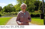 Купить «senior woman running along summer park», видеоролик № 31379350, снято 1 июля 2019 г. (c) Syda Productions / Фотобанк Лори