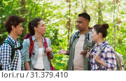 Купить «friends with backpacks hiking and making high five», видеоролик № 31379410, снято 29 июня 2019 г. (c) Syda Productions / Фотобанк Лори