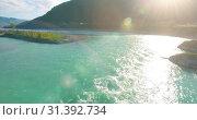 Купить «Low altitude flight over fresh fast mountain river with rocks at sunny summer morning.», видеоролик № 31392734, снято 29 марта 2019 г. (c) Александр Маркин / Фотобанк Лори