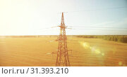 Купить «Vertical movement flight near high voltage electricity tower and power lines at green and yellow field», видеоролик № 31393210, снято 15 марта 2017 г. (c) Александр Маркин / Фотобанк Лори