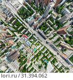 Купить «Aerial city view with crossroads and roads, houses, buildings, parks and parking lots. Sunny summer panoramic image», фото № 31394062, снято 21 января 2020 г. (c) Александр Маркин / Фотобанк Лори