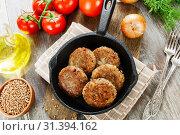 Купить «Buckwheat  burgers on the pan», фото № 31394162, снято 11 мая 2019 г. (c) Надежда Мишкова / Фотобанк Лори