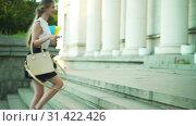 Купить «Higher education by happy girl freshwoman student go to university», видеоролик № 31422426, снято 9 июля 2019 г. (c) Gennadiy Poznyakov / Фотобанк Лори