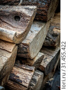 Купить «Large chunks of firewood stacked in piles outside cottage», фото № 31455422, снято 14 июля 2020 г. (c) easy Fotostock / Фотобанк Лори
