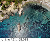 Купить «Cala en Cranc rocky seaside in the Palma de Majorca directly from above drone point of view photo, picturesque nature stony beach turquoise Mediterranean waters from top image, Balearic Islands Spain», фото № 31468098, снято 28 мая 2019 г. (c) Alexander Tihonovs / Фотобанк Лори