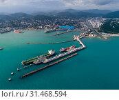 Купить «Туапсе, вид сверху на акваторию морского порта и причал для крупнотоннажных танкеров», фото № 31468594, снято 7 июня 2019 г. (c) glokaya_kuzdra / Фотобанк Лори