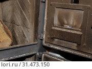 Купить «Look in the dirty stove, ready to burn», фото № 31473150, снято 15 января 2018 г. (c) easy Fotostock / Фотобанк Лори