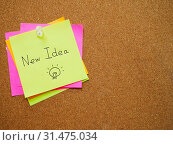 Купить «Text new idea in green post note attach by pin on wood board with copy space», фото № 31475034, снято 22 июля 2016 г. (c) easy Fotostock / Фотобанк Лори