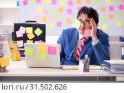 Купить «Young male handsome employee in conflicting priorities concept», фото № 31502626, снято 7 января 2019 г. (c) Elnur / Фотобанк Лори