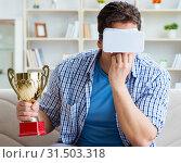 Купить «Man wearing virtual reality VR glasses receiving prize cup award», фото № 31503318, снято 18 мая 2017 г. (c) Elnur / Фотобанк Лори