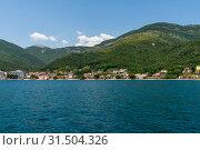 Купить «Fragment of the Bay of Kotor with houses on shore, Montenegro», фото № 31504326, снято 10 июня 2019 г. (c) Володина Ольга / Фотобанк Лори