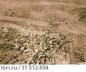 Air views of Palestine. West of Jerusalem. Upper Beth-Horon. Beit 'Ur el-Foka. the town of Beit Ur al-Fauqa (Bayt'ur Fawqa). 1931, West Bank, Bayt'ur Fawqa, Bayt'Ur (2018 год). Редакционное фото, фотограф © Liszt Collection / age Fotostock / Фотобанк Лори