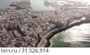Купить «General aerial view of Spanish port city of Cadiz overlooking Atlantic Ocean in sunny day», видеоролик № 31526914, снято 19 апреля 2019 г. (c) Яков Филимонов / Фотобанк Лори