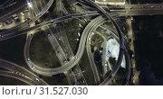 Купить «Aerial view of lighted highway road junctions at night», видеоролик № 31527030, снято 26 октября 2018 г. (c) Яков Филимонов / Фотобанк Лори