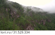 Купить «Уральские горы. Розовые скалы в тумане. Ural Mountains. Pink rocks in the mist.», видеоролик № 31529334, снято 12 июля 2019 г. (c) Евгений Романов / Фотобанк Лори